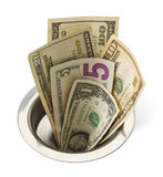 Money Down Drain. Cash Money Going Down Sink Drain Isolated on White Background Stock Images