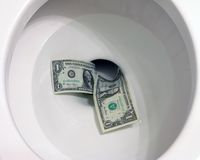 Money down the toilet Stock Image