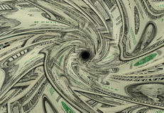 Money Drain. US currency swirls down drain stock photography