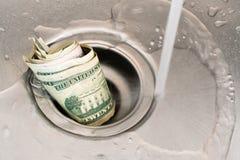 Money drain Royalty Free Stock Photos
