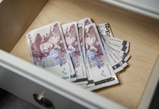 Money in the drawer Stock Photo