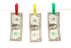 Money dries on a cord. Isolated on white background Royalty Free Stock Image