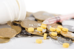 Money and drugs. On white background Royalty Free Stock Photography