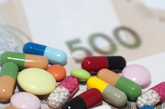 Money and drugs (medicine) stock image