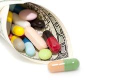Money and drugs (medicine) Stock Photos