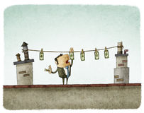 Money drying on the rooftop. Businessman drying money on the rooftop Royalty Free Stock Photos