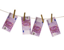 Money drying on a rope. Euro money drying on a rope Royalty Free Stock Images