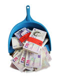 Money in dustpan Royalty Free Stock Photo