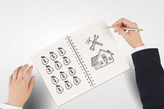 Money earning instruments. Businessman hands drawing money making formula in notepad Stock Photo