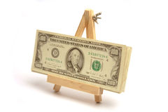 Money on easel. American dollars displayed on an easel stock photos