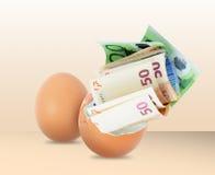 Money from egg Stock Photo