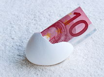 Money in egg Stock Photography