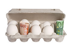 Money and eggs Royalty Free Stock Image