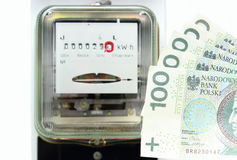 Money and electric energy meter Stock Images