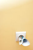 Money in electrical socket Royalty Free Stock Photo