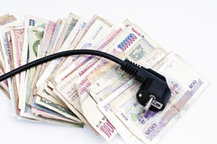 Money and electricity Royalty Free Stock Photo
