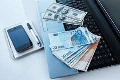 Money and electronic devices Royalty Free Stock Images