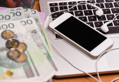 Money and electronic devices Royalty Free Stock Photos