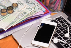 Money and electronic devices Stock Images