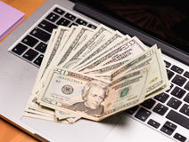 Money and electronic devices stock image