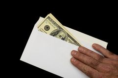 Money in envelope 10. American dollars in white envelope, isolated on a black background Stock Photos