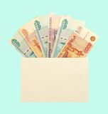 Money in envelope. Russian currency paper in cover on blue Stock Photo