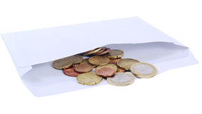 Money into an envelope. Royalty Free Stock Photo