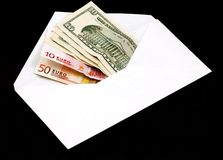 Money in envelope. On black Royalty Free Stock Images