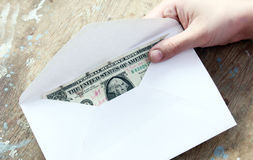 Money in envelope as a donation stock photography
