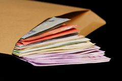 Money in an envelope Royalty Free Stock Image