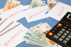 Money in an envelope and a calculator. Russian money laid out in envelopes.The distribution of the family budget Stock Photography