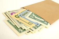 Money in envelope. Stock Photos