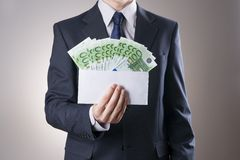 Money in an envelope in the hands of men Stock Photo
