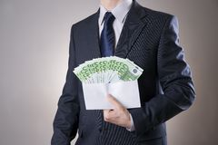Money in an envelope in the hands of men Royalty Free Stock Photos