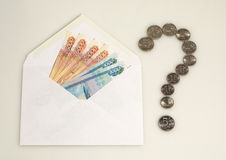 Money in envelope and question mark from coins Stock Photos