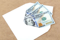 Money in envelope on wooden background Stock Image