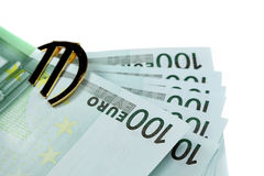 Money euro. The money euro. Bundle of bank notes  and golden sign Stock Images