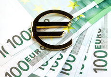 The money euro. Bundle of bank notes  and golden sign Stock Photo