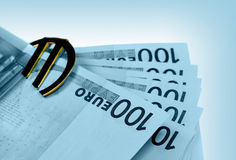 The money euro. Bundle of bank notes  and golden sign Stock Photos