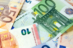 Money. Euro banknotes closeup laying on desk stock photography