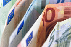 Money. Euro banknotes closeup standing on desk royalty free stock image