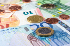 Money. Euro banknotes and coins closeup laying on desk royalty free stock photography