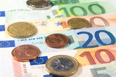 Money. Euro banknotes and coins closeup laying on desk royalty free stock images