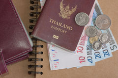 Money euro banknotes, coins,passbook and passport Royalty Free Stock Image