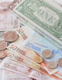 Money euro banknotes,coins and us banknotes Stock Photos