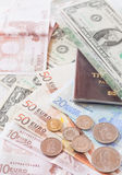 Money euro banknotes,coins,us banknotes and passport Royalty Free Stock Photography