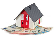 Money euro banknotes and  house. Money euro banknotes and figurine house Royalty Free Stock Photography
