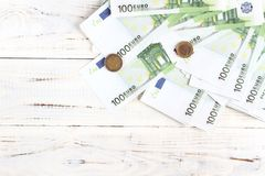 Money euro bills and coins. Money 100 euro bills and coins. Background, flatlay royalty free stock photo