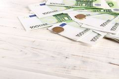 Money euro bills and coins. Money 100 euro bills and coins. Background, flatlay royalty free stock photography