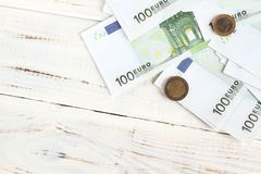 Money euro bills and coins. Money 100 euro bills and coins. Background, flatlay stock photos